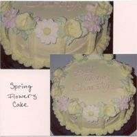 "Spring Flowers Cake 8"" Round iced in buttercream and decorated with Royal icing daisies and buttercream roses."