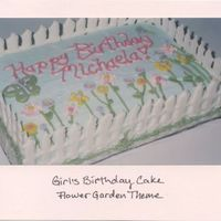 Girl's Birthday- Flower Garden 9x13 cake decorated with piped butterceram flowers. Fence is made from color flow.