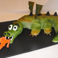 Fire-Breathing Dragon This cake took some time. Each fondant scale was cut out individually. There were 92 on each leg!!!!! It is choc cake and the head is...