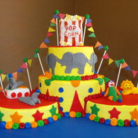 Circus Theme 9 inch rounds with all fondant accessories except the flags are paper and the popcorn is marshmellows