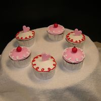 Fair Entry Cuppies I was trying to copy some really cute cupcake fabric I saw, kinda cutey retro cuppies on a pink background. These were my entry for my...