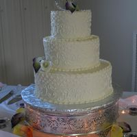 Scroll And Dot Wedding Cake This was for a family members wedding. I wasn't crazy about the design, but I think it ended up looking okay. The lily's are...