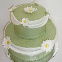 Stacked Daisy Swag Cake I wanted to try fondant swags outside of a class for once. Buttercream with fondant accents.