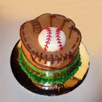 Baseball Glove All buttercream except the fondant around the baseball. This one was fun!