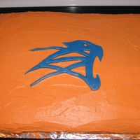 Cougar Football Logo Cake This was a lemon cake on one side, chocolate layer cake on the other with IMBC and the logo MMF.
