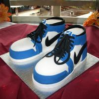 Air Jordans Sculpted Air Jordans sculpted in fondant with blue and black details. This was a groom's cake for a rehearsal dinner.