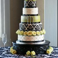 "Round Damask Wedding Cake 4-tier round wedding cake on custom-made cake stand. Black damask pattern on 6"" and 12"" tiers. Bottom tier quilted with black..."