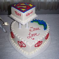 "Superman! This cake was made for a huge Superman fan. The lettering on the side of the top tier is Kryptonian for ""True Love."" The cake was..."