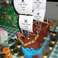 Pirate Ship 3-D Cake My second attempt at a pirate ship cake. Much easier and looksbetter than the first one! The birthday boy loved it.
