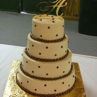 "Brown And Ivory 4 Tier Wedding Cake   4 Tier's 6,8,10,12"" White and choc. cakes."