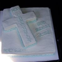 First Communion square is half chocolate and half butter cake, cross is french vanilla cake and frosted inbuttercream
