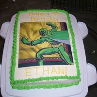 Zander Power Ranger Cake Chocolate cake, buttercream icing. Simple decoration with an edible image.