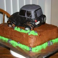 Jeep Grooms cake. Jeep is made fro rice krispy treats and covered in fondant. Cake is all chocolate