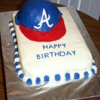 Baseball Hat Buttercream w/ fondant bill and letters on hat.
