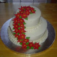 Cascading Poinsettias Buttercream with Royal icing poinsettia's. Holiday cake for my mother's work