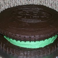 "Mint Oreo Decided to try my hand at the oreo cookie cake. I decided to make mine mint. The ""cookie"" is chocolate cake with mint oreo pieces..."