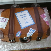 Luggage Cake buttercream cake with choco pan accents. Edible images on top.