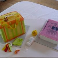 Diaper Bag, Book And Goodies Thank you Suzyqqq27 for all your help. I made the diaper bag using fondant accents over bc. The book is bc with an edible image. I tried...