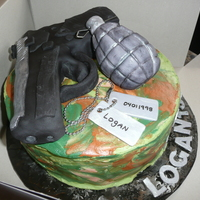 Call Of Duty Birthday Cake red velvet with cream cheese icing. Gun and grenade made out of rkt. Dog tags fondant.