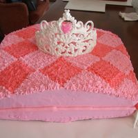 "Fit For A Princess Royal icing crown fit for a princess atop a ""Royal"" pillow."