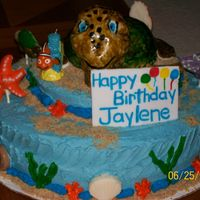 100_1533.jpg This cake is for my cousin daughter who is turning 1. My cousin loves turtledso my cousin did the Nemo theme but told me to place a big...