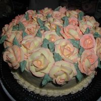 Full Of Roses All roses were made of two-toned royal icing to represent the Joseph's coat rose, my mom's favorite.
