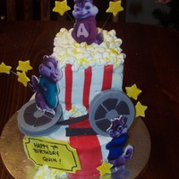Alvin And The Chipmunks!   8 inch round, 6 inch round cut down. Marshmellow popcorn. Fondant accents.
