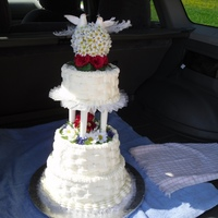 Silk Flowers And Doves Was asked to do a cake for a park reception, and the bride wanted silk flowers. She was carrying daisies and roses, so I made the topper...