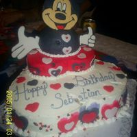 Mickey Valentine Birthday Cake This was my nephew's 1st Valentine B-day Cake. This is how it looks now with Mickey's face and hands. You may see that it has...