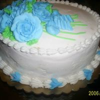 Blue Roses My graduation cake from my level 1 decorating cake classes. Made the roses of buttercream frosting.