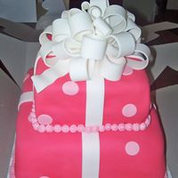 Pink Polka Dot Cake W/bow I MADE THIS CAKE FOR A CUSTOMER WHO WANTED HER DAUGHTER TO HAVE A CAKE THAT LOOKED LIKE BOXES WRAPPED AND A BOW ON TOP....DID MY BEST......