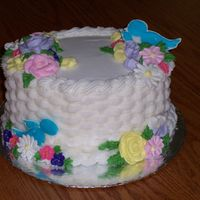 Wilton Course Ii Final Cake Small oval cake, basketweave with BC, flowers in Royal and Birds in color flow.