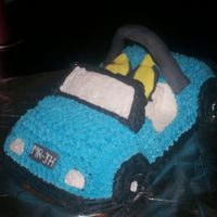 Dune Buggy Cake Lemon Pound cake iced in buttercream, with fondant accents. Roll Bar is a drinking straw.
