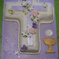First Communion Cake This is a 12x18 sheet cake with the cross pan that I made for my niece. The rosary, purple cross, chalice and wafer are fondant.