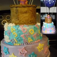"Dora peanut butter flavored cake with grape jelly and cream cheese icing filling. 4"", 6"", 8"" cakes. covered in fondant."