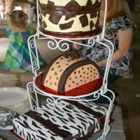 Going Away Animal Print Luggage Cake top two were vanilla cake, bottom was chocolate. iced in buttercream and fondant accents.