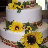 Sunflower Wedding Cake The bride wanted a neopolitan cake! Bottom tier is white cake with buttercream; middle tier is chocolate cake with chocolate ganache; top...