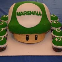Super Mario Mushroom This was done for a little boy's 9th birthday. He wanted the green one-up mushroom from Super Mario. The actual mushroom is white cake...