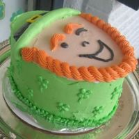 Side Of Leprechaun Cake Side view. I tried to do shamrocks on the side, with a leaf border.