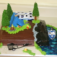 Camping Cake I madethis cake for my grandson. It is buttercream with fondant decorations. The trailor and boat are toys (he likes to have toys included...