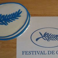 Festival De Cannes Logo Small oval yellow cake with vanilla buttercream. Logo from Cannes Film Festival.