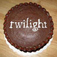 Twilight  8-inch round cake, one layer dark chocolate fudge and one layer white cake. Hershey's Perfectly Chocolate Chocolate frosting with a...