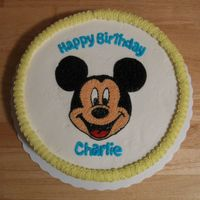 Mickey Mouse   10-inch round yellow cake with chocolate bravarian cream filling and vanilla buttercream frosting.