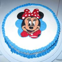 Minnie Mouse  10-inch round dark chocolate fudge cake with vanilla buttercream frosting. Made just for fun and ran out of time, not as precise and clean...