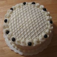 Lattice Lemon Blueberry Cake  2 layer 8-inch round lemon cake with lemon zest buttercream, filled with fresh blueberries and blueberry preserves. Used for a small party...