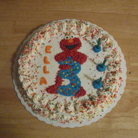 Elmo Cake Single layer 10-inch round cherry chip cake frosted with buttercream. Sprinkles covered a lot of mistakes during the decoration process.
