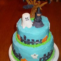 Kids Halloween Party This is a cake for my children's halloween party. The top layer was pumpkin and the bottom was vanilla. All covered with buttercream...