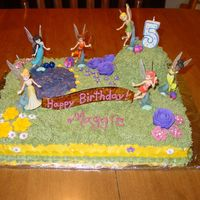 Tinkerbell And Fairies  This was for my daughter's fifth birthday. She saw a similar cake on this site, and LOVED it, and insisted that was what she wanted. I...