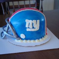 Giants Football Helmet My first attempt at a helmet cake! Thanks for all the inspiration from CCers! It came out pretty good! 2 8 inch rounds, topped with the...
