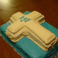 Baptism Cake  Cake was 11 x 15 Choc. cake with buttercream icing, and cross was vanilla cake with white buttercream. (customer only wanted BC, no fondant...